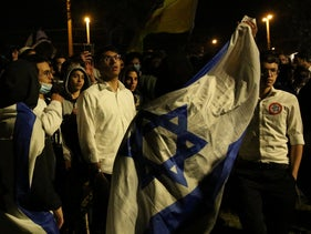 Supporters of the far right Lehava on the prowl, one wearing a 'Kahane was right' badge, in Jerusalem last month