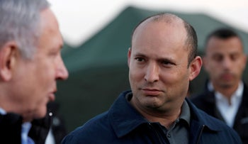 Naftali Bennett and Benjamin Netanyahu during a visit to an Israeli army base in the Golan Heights, in 2019.