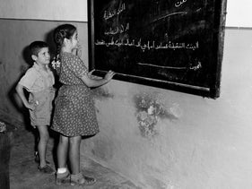A brother and sister, the only two Jewish children in a new Arab school in Haifa established in October 1948, led by well-known Palestinian educator Hasan Farahat. All studies were in Arabic, with English and Hebrew also taught