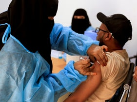 A man receives the AstraZeneca COVID vaccine at a medical center in Taiz, Yemen, last month.