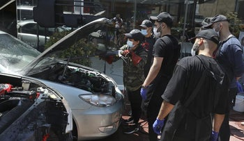 Female Iranian car detailer Maryam Roohani cleans a car spraying water as her trainees watch, at a detailing shop in Tehran, Iran.