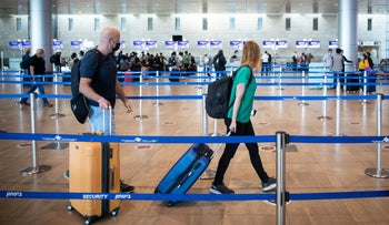 Travellers at Ben Gurion airport in April.