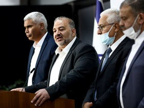 Mansour Abbas (second from the left) and United Arab List lawmakers in the presidential residence presenting their recommendation for Prime Minister to President Reuven Rivlin, last month.