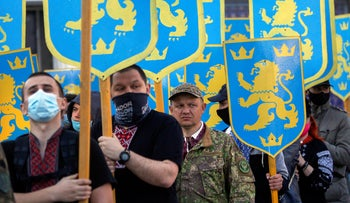 Ukrainian nationalists carry emblems of the so-called 1st Galician Division during a commemorating march in Kyiv, Ukraine, last week.