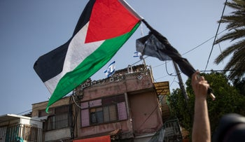 A protester waves a Palestinian flag in Sheikh Jarrah, last month.