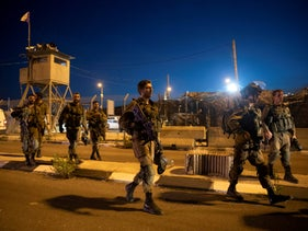 Israeli soldiers at the scene of the shooting at Tapuah Junction, earlier this week.