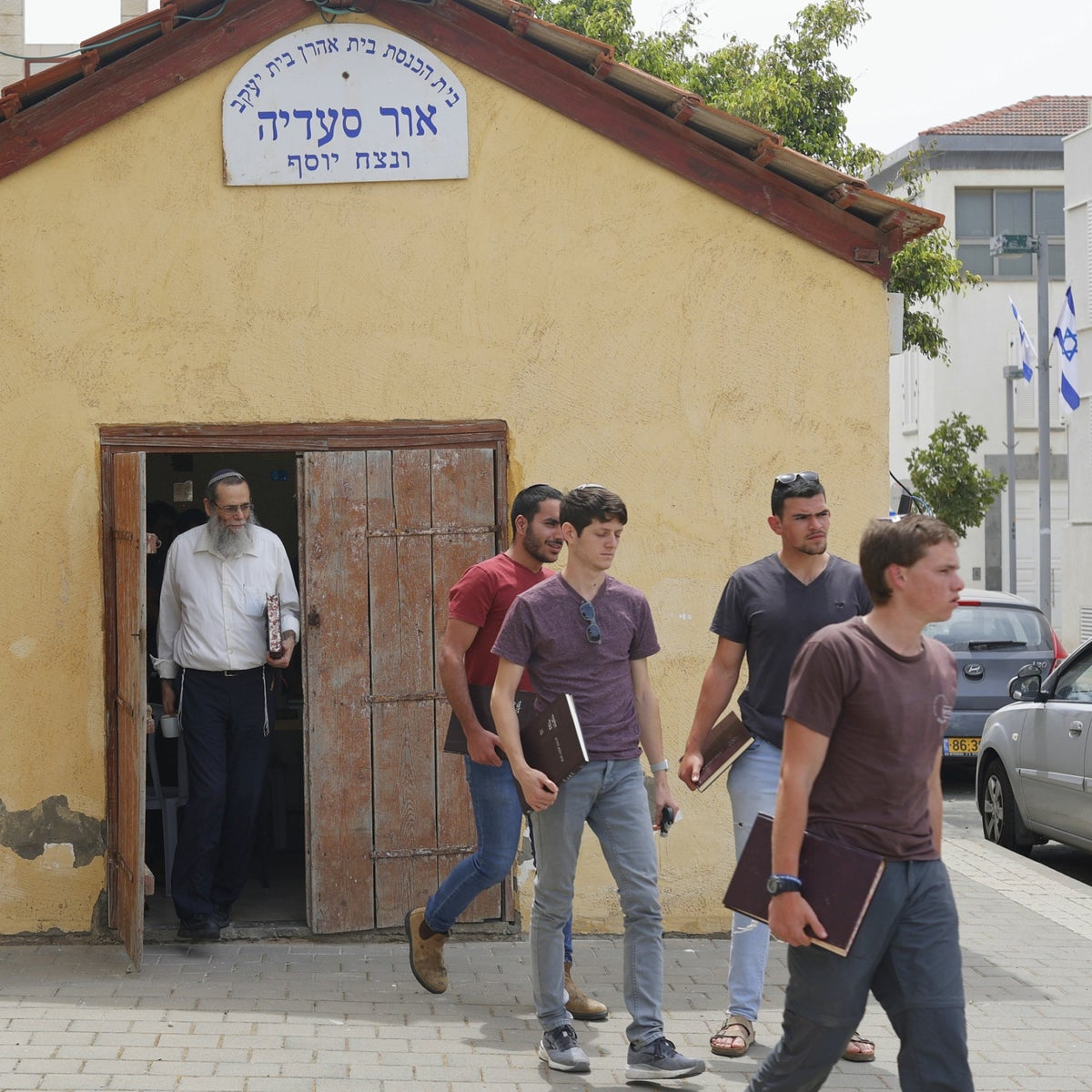 Rabbi Mali leaving his yeshiva in Jaffa, the day after the riots last month.