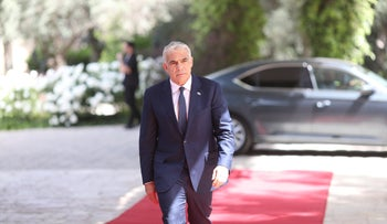 Yair Lapid enters the presidential residence in Jerusalem, today.