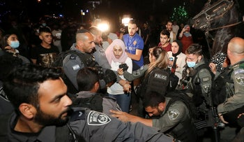 A Palestinian resident reacts during scuffles with Israeli in Sheikh Jarrah, East Jerusalem, May 2021.