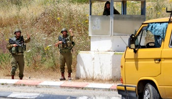 Israeli soldiers search cars at the southern entrance to Nablus city, a day after a terror attack at a bus stop at Zaatara (Tapuach) junction south of the city.
