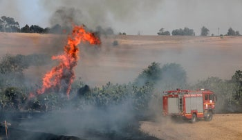 A fire started by a balloon from Gaza in southern Israel, today.