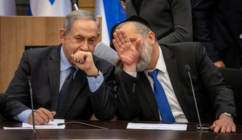 Benjamin Netanyahu and Arye Dery at a Knesset meeting last year.