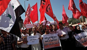 Supporters of the Popular Front for the Liberation of Palestine (PFLP) protest in Gaza, 2013.