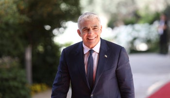 Yair Lapid arrives to the president's official residence to accept the mandate to form government
