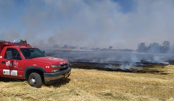 A firetruck on the scene of the fires in Eshkol, earlier today