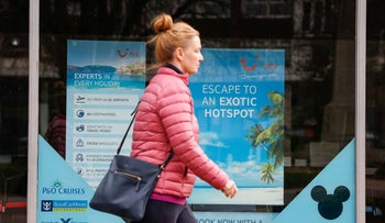 A woman walks past the TUI travel center in Harpenden, Britain, two months ago.