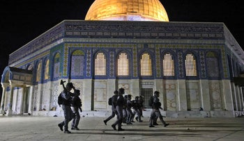 Israeli Police patrolling the Al-Aqsa mosque compound last night, where 200 Palestinians were injured as well as 17 Israeli police officers