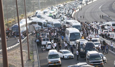 Route 1 to Jerusalem closed to traffic as Muslim worshippers make their way to Al Aqsa on Saturday.
