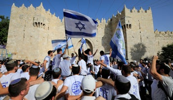 Religious Zionist youth celebrate during the Flag March outside Damascus Gate in Jerusalem, in 2019.