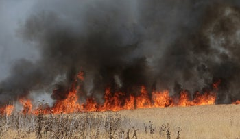 Fire sparked by arson balloon in Israeli field near Gaza border, May 2021.
