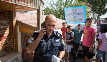 Palestinians protesting against the planned eviction of Palestinians from their homes in Sheikh Jarrah.