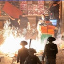 Palestinians react as Israeli police fire a stun grenade during clashes at Damascus Gate on Laylat al-Qadr during the holy month of Ramadan, in Jerusalem's Old City, May 9, 2021.
