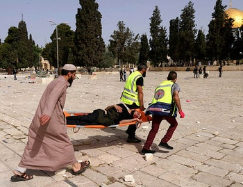 Palestinian wounded on the Al-Aqsa compound after clashes with Israeli security forces, May 2021.