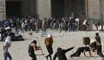 Palestinians clash with Israeli security forces at the Al Aqsa Mosque compound in Jerusalem's Old City  earlier today