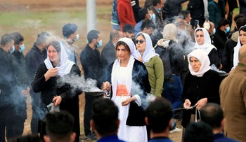 Yazidis women attend the funeral of people from the minority Yazidi sect, who were killed by Islamic State militants, after they were exhumed from a mass grave, in Kojo, Iraq.