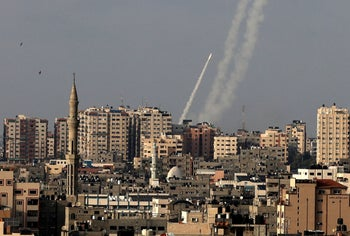 Rockets are fired from Gaza City towards Israel, today.