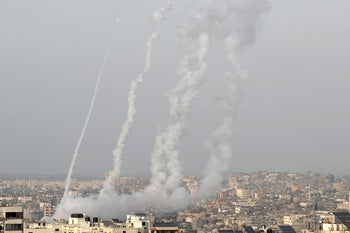 Rockets are launched by Palestinian militants into Israel, in Gaza, today.