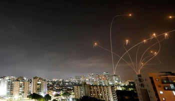 Israel's Iron Dome anti-missile system intercepts rockets launched from Gaza on Monday, as seen from Ashkelon.