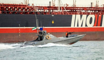 Iranian Revolutionary Guards in speedboats patrolling a tanker off the Iranian port city of Bandar Abbas in 2019.