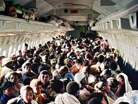 Ethiopian Jews onboard an Israel Air Force Boeing 707, during their transfer from Addis Ababa to Tel Aviv, in 1991.
