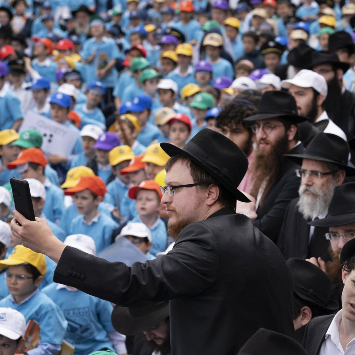 Hundreds of Orthodox men and boys attending a Lag Ba'omer holiday celebration in front of the Chabad Lubavitch World Headquarters in New York last month.