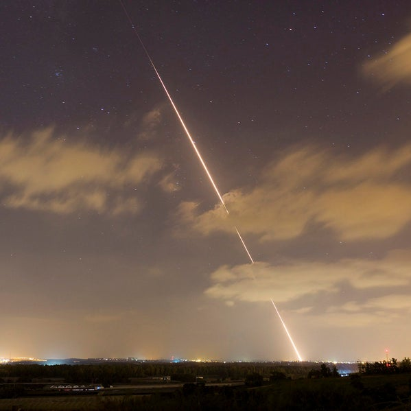 A streak of light is seen as a rocket is launched from the northern Gaza Strip towards Israel August 21, 2014.