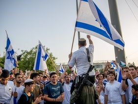 Young Jewish demonstrators during the Jerusalem Day parade in Jerusalem yesterday.