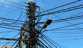 Electricity cables are seen in Tyre, Lebanon, last year.