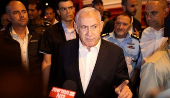 Netanyahu tours the city of Lod early on May 12, 2021.