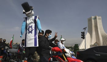 A demonstrator on a motorcycle holding an effigy representing Israel and the United States during the annual Al-Quds Day rally in Tehran earlier this month.