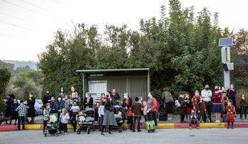 Haredi Israelis at a bus stop in Jerusalem in February.