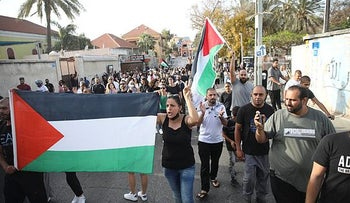 Protesters demonstrating with Palestinian flags in Jaffa on Monday.