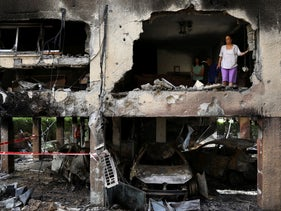 An apartment building in Petah Tikva after it was hit by a rocket fired from the Gaza Strip over the night.