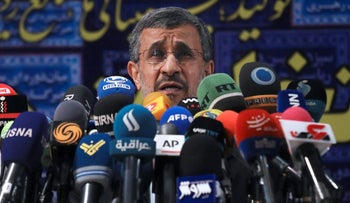 Former President Mahmoud Ahmadinejad speaks with the media after registering his name as a candidate for the June 18 presidential elections at elections headquarters of the Interior Ministry in Tehran, Iran, Wednesday, May 12, 2021.