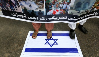 Supporters of the Pakistani religious group Sunni Tehreek Pakistan at a rally to condemn Israel's use of force against the Palestinians, in Karachi, today.
