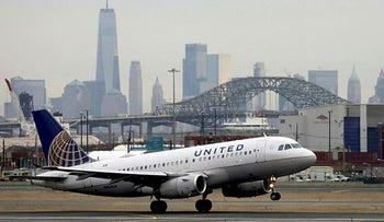 A United Airlines passenger jet taking off at Newark Liberty International Airport, December 2019.