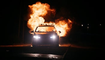 A burning police car in the mixed city of Lod, two days ago.