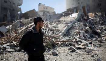 A Palestinian policeman stands in the rubble of a building destroyed by an Israeli airstrike that housed The Associated Press' offices in Gaza City, Saturday, May 15, 2021.
