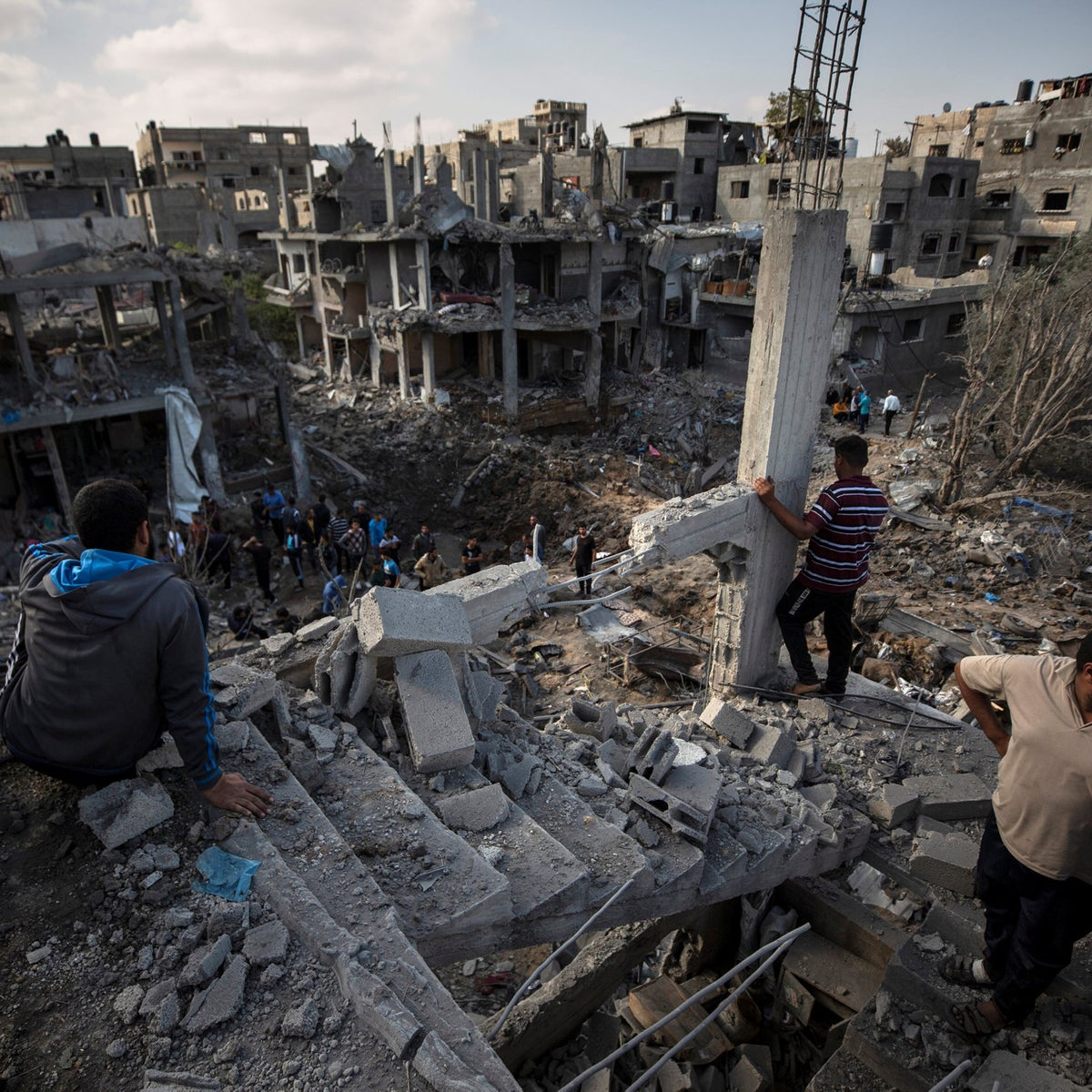 Palestinians inspect their destroyed houses following overnight Israeli airstrikes in town of Beit Hanoun, northern Gaza Strip.