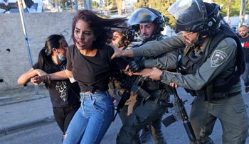 Israeli security forces try to detain a Palestinian woman in the east Jerusalem neighborhood of Sheikh Jarrah.